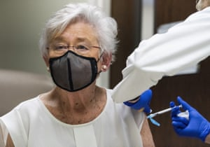 Alabama Governor Kay Ivey receiving a Covid vaccine dose earlier in the year.