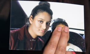 Renu Begum, sister of Shamima Begum, holds a photo of her sister in 2015.