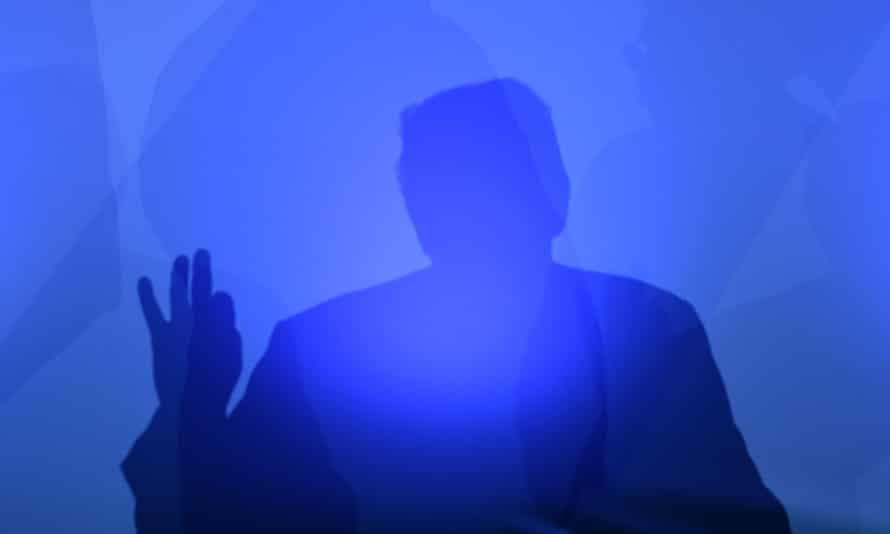 Donald Trump casts a shadow as he addresses a press conference.