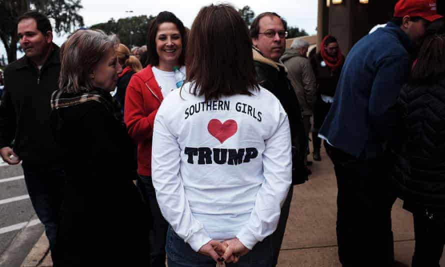 Donald Trump supporters wait to hear him speak at the Mississippi Coast Coliseum in January.