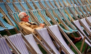 A man sits on a deckchair before an outside concert at Kenwood House in north London