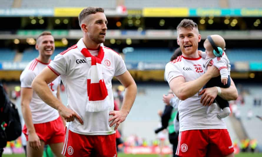 Members of the Tyrone team take in their Gaelic football victory at Croke Park, Dublin.