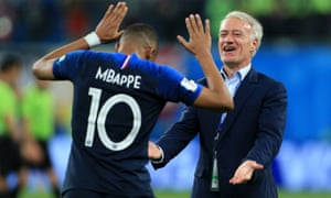 Didier Deschamps and Kylian Mbappé celebrate after the semi-final win over Belgium.
