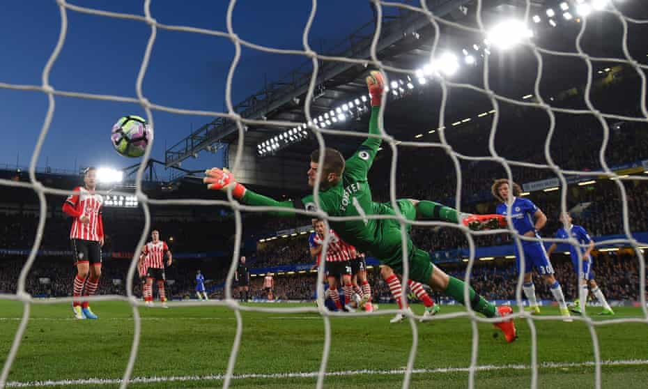 Fraser Forster is beaten by Gary Cahill's header during Chelsea 4-2 win at home to Southampton.