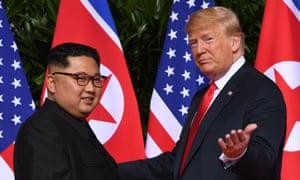 President Donald Trump (R) meets with North Korea's leader Kim Jong Un