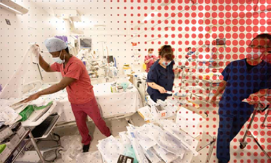 Staff at a London Hospital turn a recovery area into and ICU ward