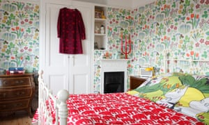 The master bedroom with Swedish wallpaper.
