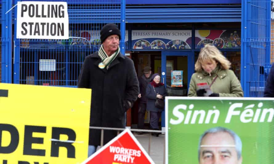 Voters leave a polling station in Belfast.