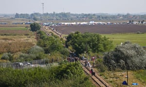 Migrants rush to cross the Serbian-Hungariar border<br>at Roszke.<br>