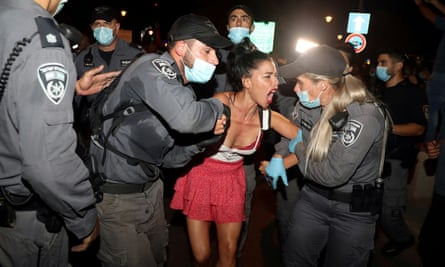 Police detain a woman during a protest early on Friday.