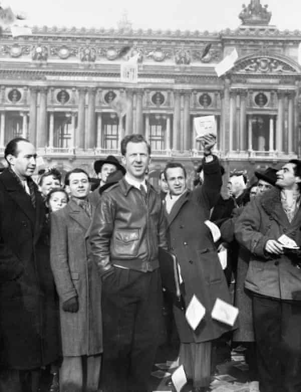 Garry Davis with some of his supporters as they distribute pamphlets in Paris.