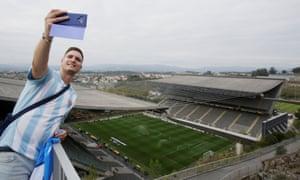 A Slovan Bratislava fan takes a selfie from on top of the rock.