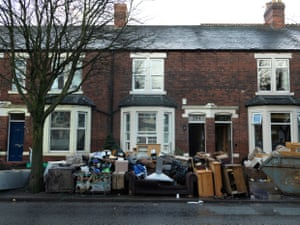 The ruined contents of flooded Warwick Road homes are piled up on the streets