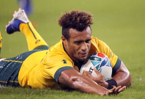 Australia's Will Genia slides cross the line to score a try.