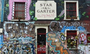 The graffiti-covered front of the Star and Garter pub in the Montpelier district of Bristol, which closed in February.