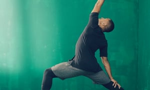 A man stretches in a yoga pose