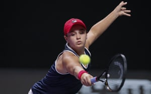 Ashleigh Barty stretches for a backhand return.