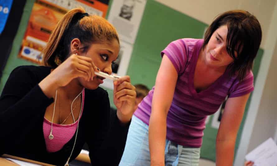 Teenage student with tutor.