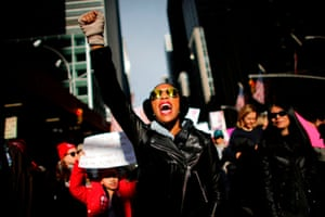 A woman shouts as she attends the Women's March on New York City