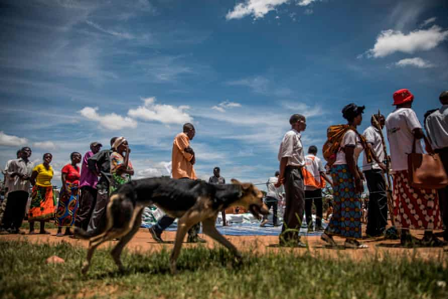 People await for food to be distributed by the World Food Programme and World Vision in Simumbwe, Zambia, on 22 January.