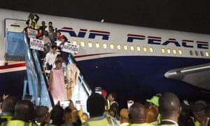 Nigerians arrive in Lagos after being send back from South Africa on 11 September.