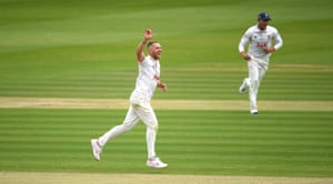Jamie Porter of Essex celebrates the wicket of George Bartlett.