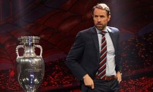 Gareth Southgate walks past the Euro 2020 trophy at Saturday's draw.