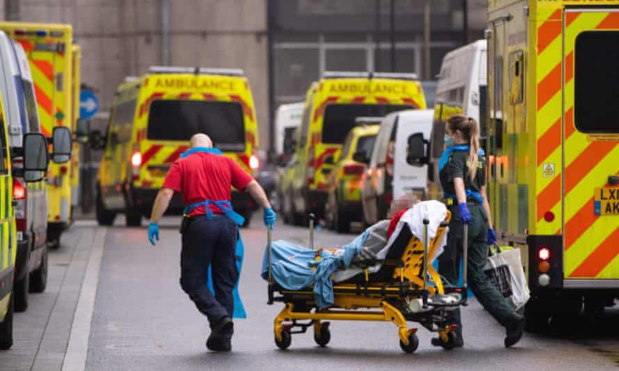 Paramedics unload a patient from an ambulance outside the Royal London Hospital in January 2021, at the peak of the UK's second wave.