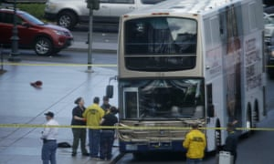Las Vegas police investigate the scene of a stand-off in a bus along Las Vegas Boulevard, on Saturday.