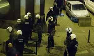 Police in the sealed off Molenbeek neighborhood of Brussels.