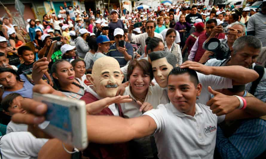 Delfina Gomez poses for a selfie with supporters during a campaign rally in Chalco, Mexico state.
