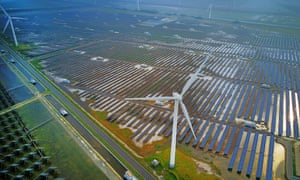 Wind turbines and solar panels in Yancheng, Jiangsu province of China
