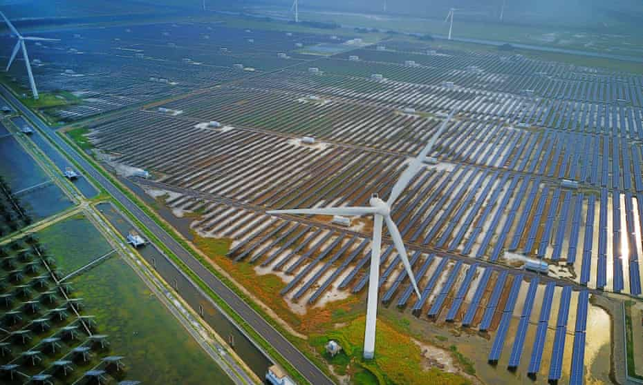 Aerial view of an industrial base consisting of wind turbines, solar panels and fish ponds at tidal flats on July 25, 2017 in Yancheng, Jiangsu Province of China.