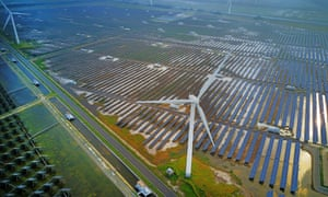 A combined installation of wind turbines and solar panels at Yancheng, Jiangsu province.