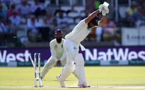 Stuart Thompson of Ireland is bowled out by Stuart Broad of England.