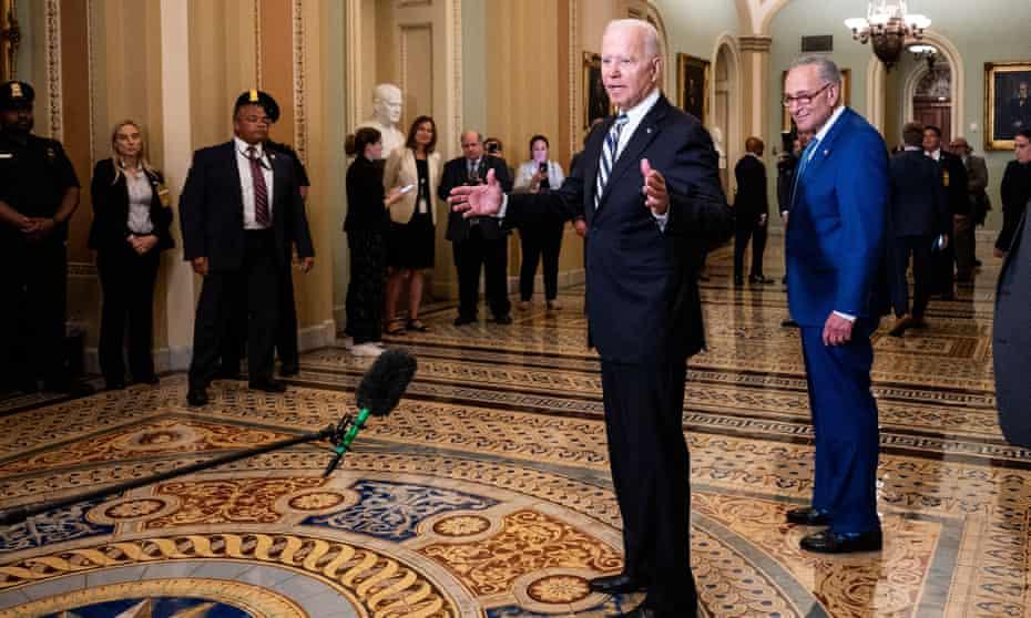 Joe Biden, with the majority leader, Chuck Schumer, visits the Senate, where some of his key legislative objectives have hit a roadblock.
