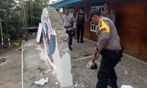 Indonesian authorities dismantling signage at a Free West Papua campaign office in Timika.