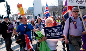 Pro-Brexit demonstrators in Parliament Square, one holding a placard reading 'No deal? No problem!'