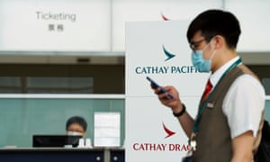A Cathay Pacific employee wearing a face mask following the coronavirus disease outbreak, walks past a ticketing counter at Hong Kong International Airport in Hong Kong, China 20 October 2020.