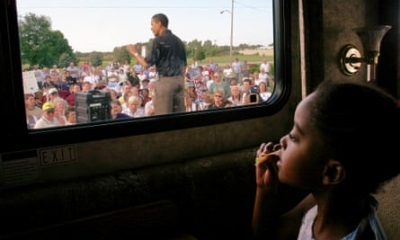 Barack Obama campaigning for the US Senate in 2004, watched by daughter Malia