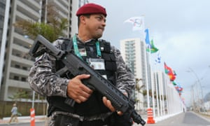 An armed police officer at the Olympic village in Rio close to where a man reported to be a diplomat fought off two muggers on Thursday.