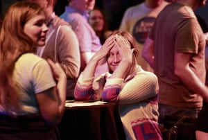 Lisa Anderson reacts as CNN predicts Republicans will maintain control of the Senate during an election viewing party at a bar called Piano Fight in San Francisco, California