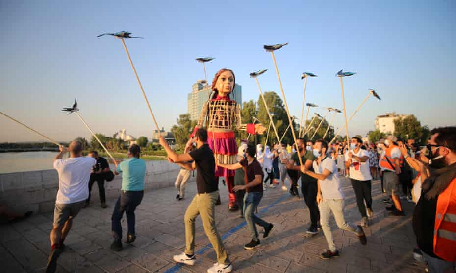 Little Amal, the giant puppet trekking from the Syria-Turkey border to Manchester, in a live art show of solidarity with asylum seekers.