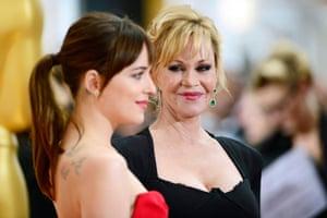 Melanie Griffith looks at her daughter Dakota Johnson