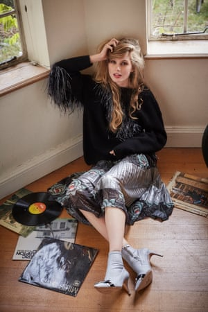 Charlie wears fringed sweater, £695, and printed skirt £855, both Dries Van Noten, harveynichols.com. Andie bow boots, £475, sophiewebster.com
