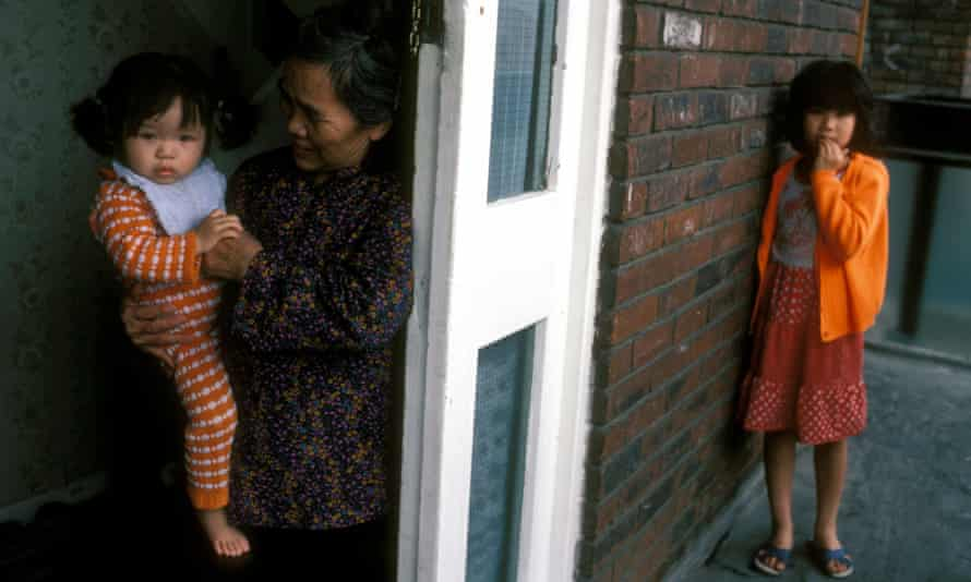 A family of Vietnamese 'boat people' in the Isle of Dogs, London, in 1993
