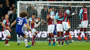 Chelsea's David Luiz's freekick only finds the wall.