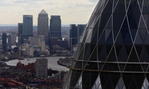 The London skyline as seen from Tower 42 with 'the Gherkin' (foreground) and Canary Wharf (background) prominent