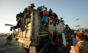 Honduran migrants travel toward the US from Huixtla, Chiapas state, Mexico, on 24 October.