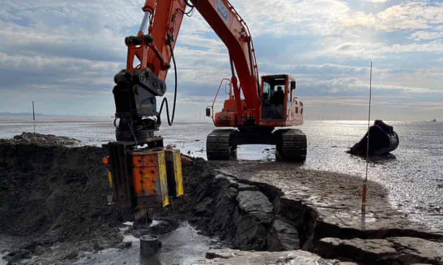 Excavation work on the beach
